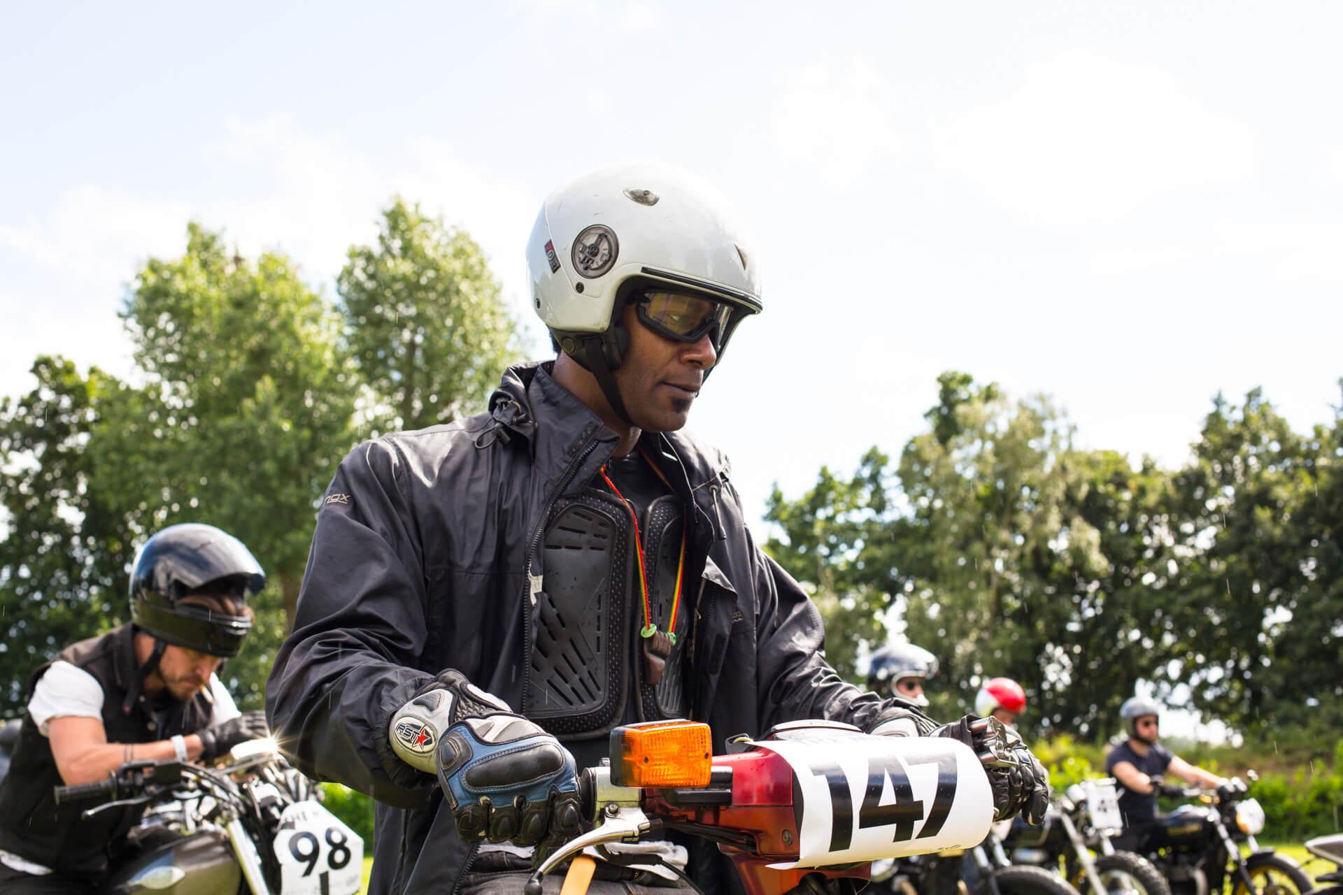 Malle Mile, Event, Motorcycle, Richard, Summer, WeAreShuffle, Agency, Photography, Film, Production, Malle London, Triumph, Flag, Biker, Field, Race, Helmet, Dirt, Scooter