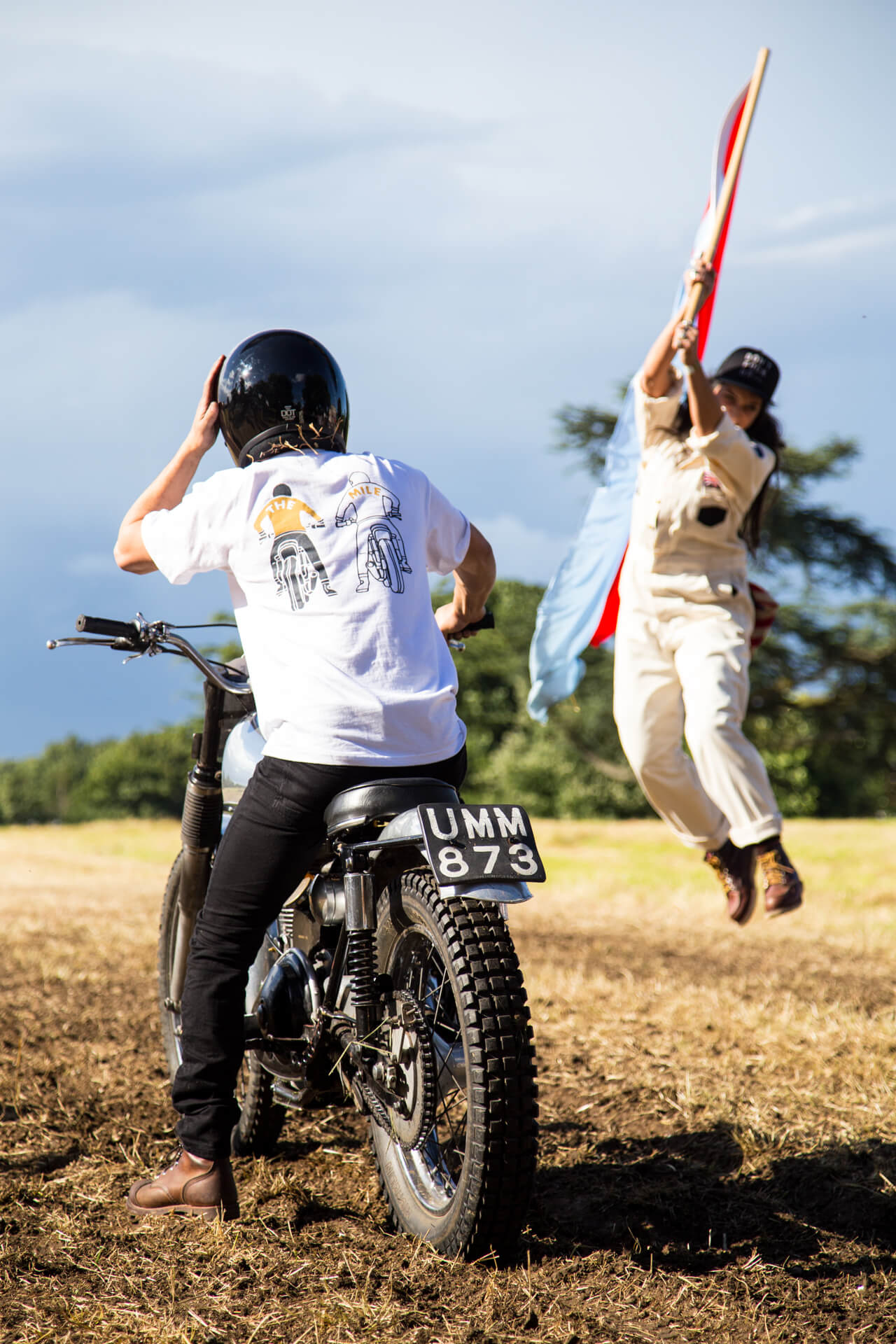 Malle Mile, Event, Motorcycle, Richard, Summer, WeAreShuffle, Agency, Photography, Film, Production, Malle London, Triumph, Flag, Biker, Field, Race, Helmet, Dirt, Air, Jump