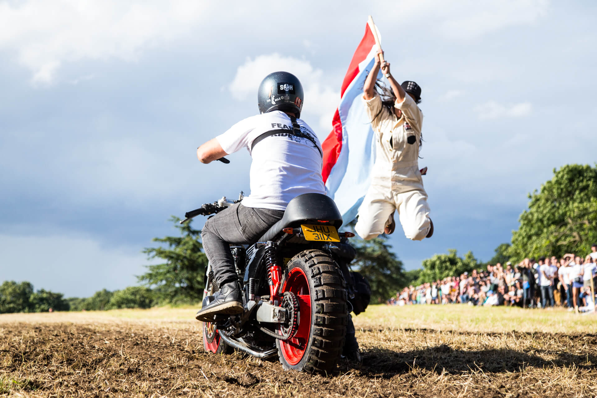 Malle Mile, Event, Motorcycle, Richard, Summer, WeAreShuffle, Agency, Photography, Film, Production, Malle London, Triumph, Flag, Biker, Field, Race, Helmet, Dirt, Girl